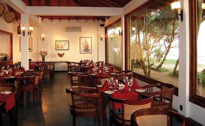 Weligama Bay Resort Sri Lanka restaurant indoor dining area with large windows