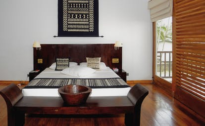 Weligama Bay Resort Sri Lanka royal suite bedroom with black and white decor and large windows