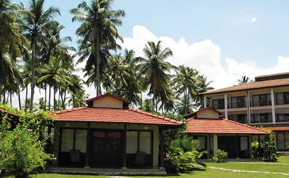 Weligama Bay Resort Sri Lanka villa exteriors with palm trees overlooked by hotel