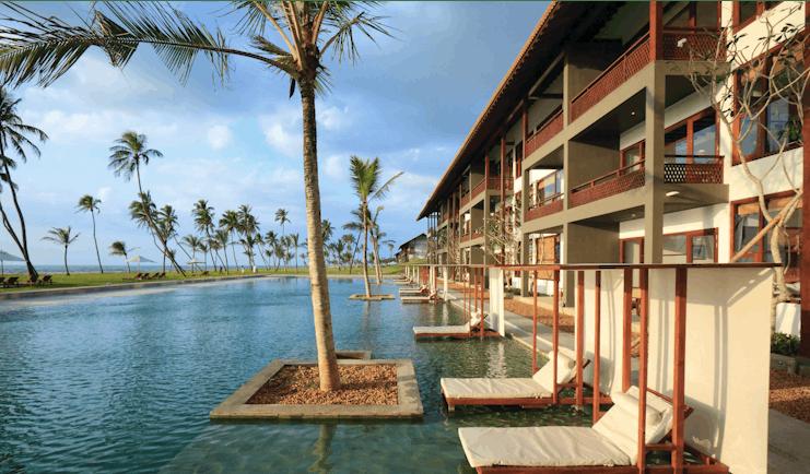 Anantaya Chilaw Resort Sri Lanka pool sun loungers palm trees ocean views