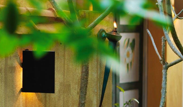 Ayurveda Pavilions Sri Lanka building yellow walls painted doors wall torch