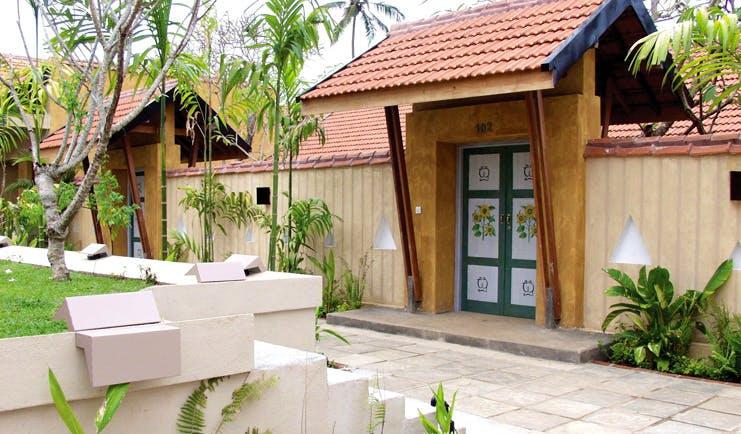 Ayurveda Pavilions Sri Lanka hotel exterior fence painted gates bamboos
