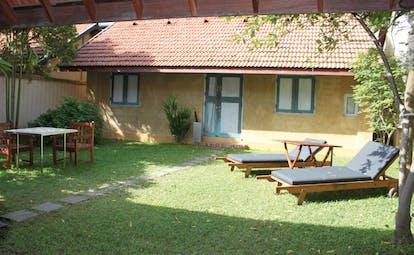 Ayurveda Pavilions Sri Lanka king villa exterior bungalow table sun loungers