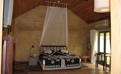 Ayurveda Pavilions Sri Lanka large bedroom black and white bed mosquito drapes