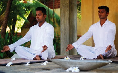 Ayurveda Pavilions Sri Lanka yoga two men in white practicing yoga