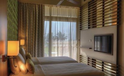 Heritance Negombo Sri Lanka deluxe room bed television modern décor
