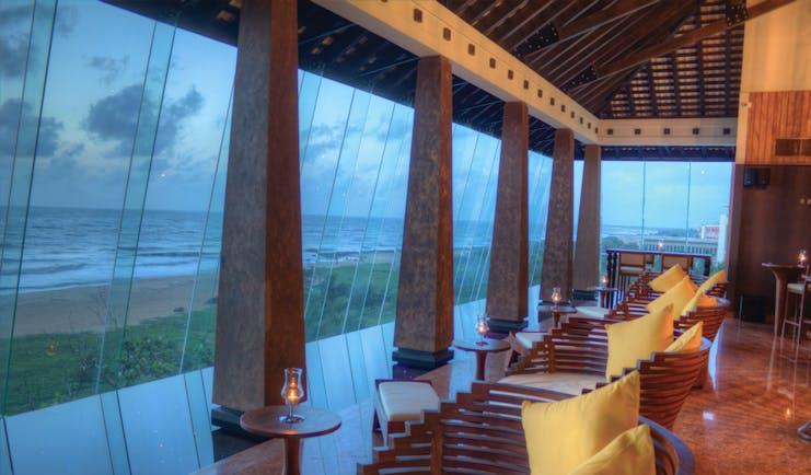 Heritance Negombo Sri Lanka lounge indoor communal seating area large glass windows sea views