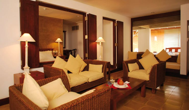 Jetwing Beach Sri Lanka luxury suite lounge area sofas table view of bed