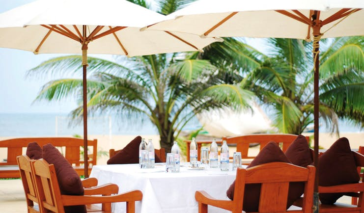 Jetwing Beach Sri Lanka outdoor dining white table umbrellas trees