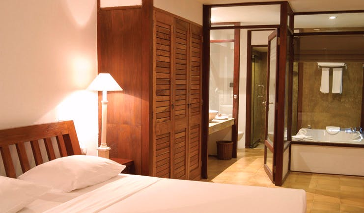 Jetwing Beach Sri Lanka suite white bed windows to bathroom and large bath