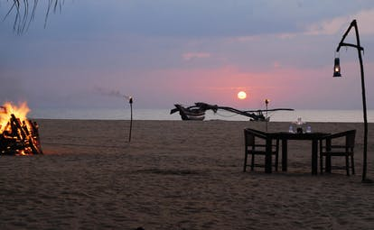 Jewting Beach Sri Lanka sunset dining on the beach table set for two bonfire