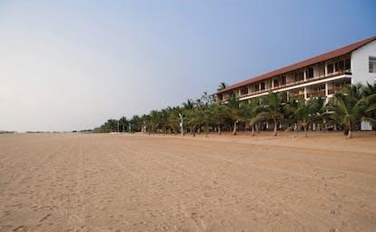 Jetwing Blue Sri Lanka beach long sandy beach palm trees hotel building
