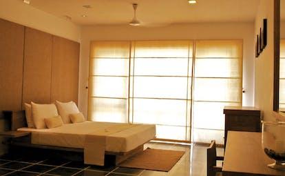 Jetwing Blue Sri Lanka bedroom with large windows minimalist decor