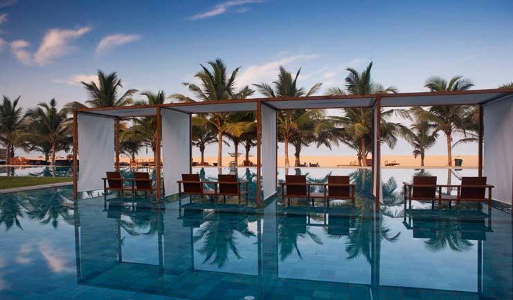 Jetwing Blue Sri Lanka pool sun loungers umbrellas palm trees