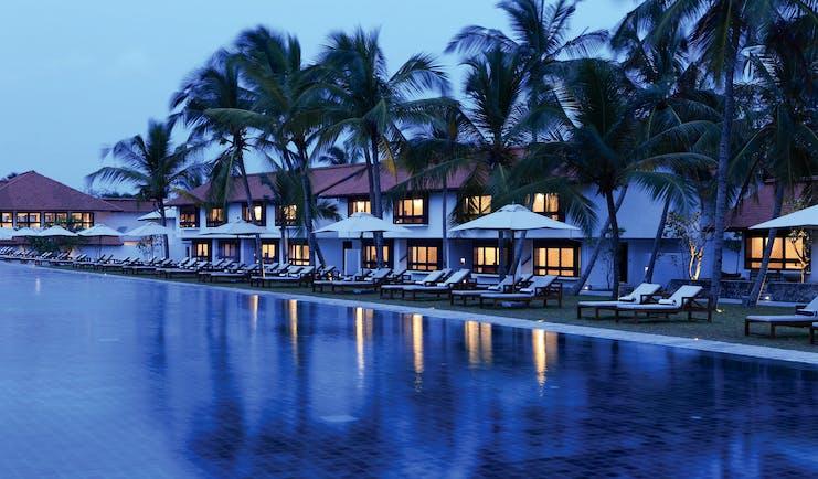 Jetwing Lagoon Sri Lanka pool palm trees sun loungers umbrellas
