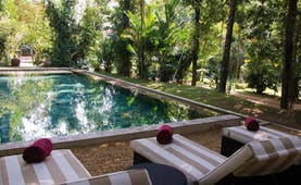 The Wallawwa Sri Lanka outdoor pool sun loungers palm trees