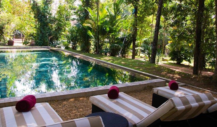 The Wallawwa Sri Lanka outdoor pool sun loungers palm trees