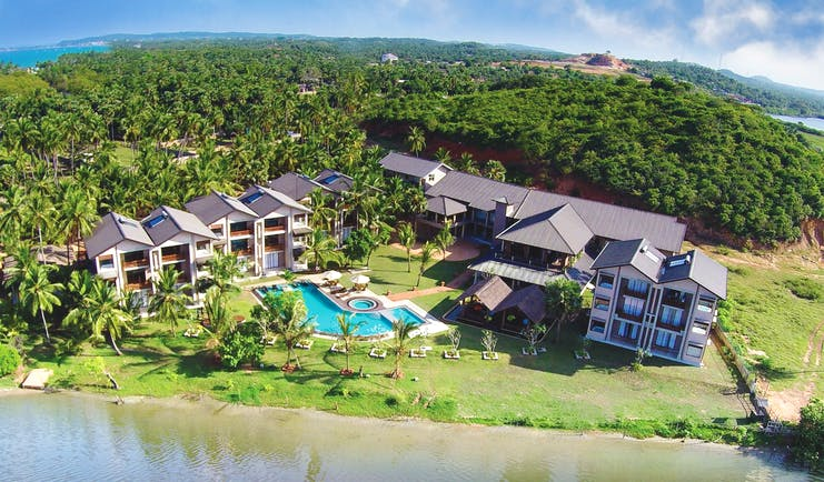 Aramanthe Bay Sri Lanka aerial hotel buildings pool gardens forest background