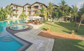 Aramanthe Bay Sri Lanka exterior hotel buildings palm trees lawns pool