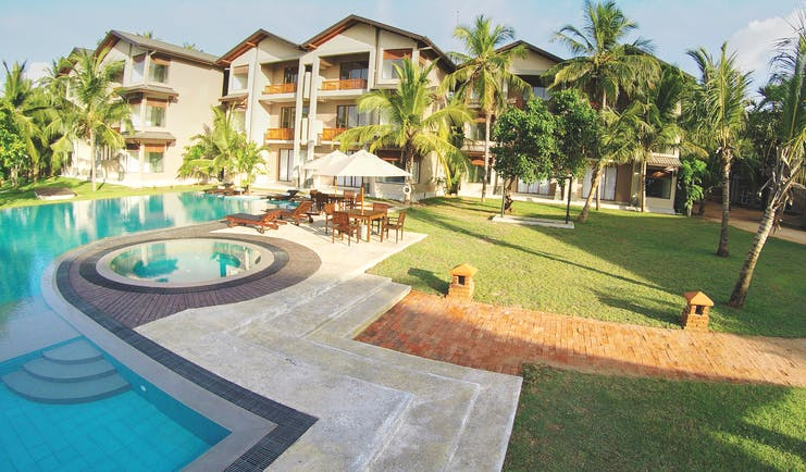 Aramanthe Bay Sri Lanka exterior hotel buildings palm trees lawns pool