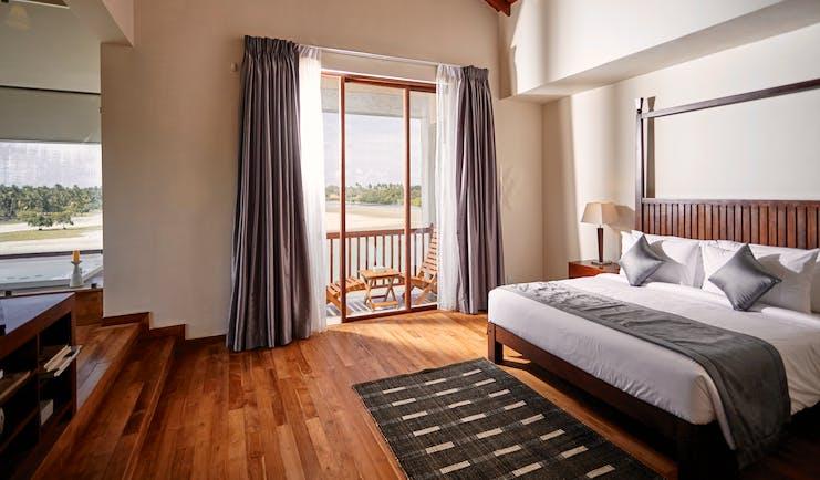 Aramanthe Bay Sri Lanka junior guest suite bed wooden floors modern décor