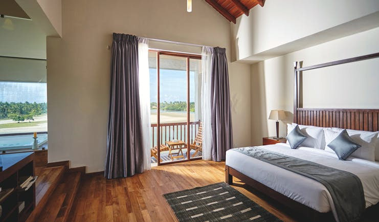 Aramanthe Bay Sri Lanka junior guest suite bed wooden floors modern décor
