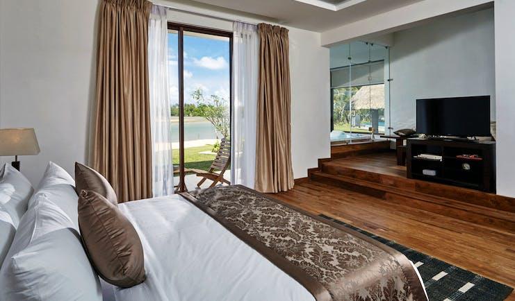 Aramanthe Bay Sri Lanka junior suite bed wooden floors private terrace