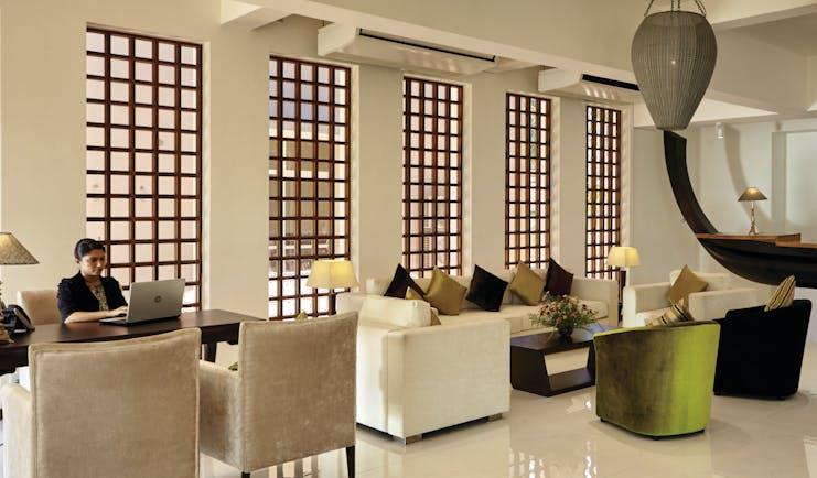 Aramanthe Bay Sri Lanka lounge indoor communal seating area sofas chairs modern décor