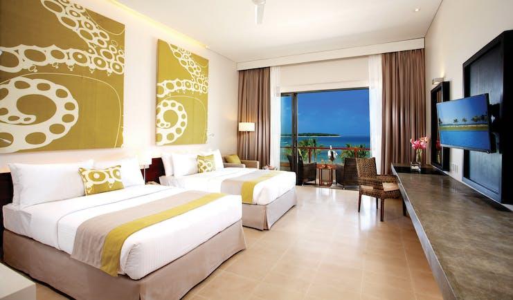 Amaya Beach Resort Sri Lanka deluxe room beds modern art modern décor private terrace ocean views