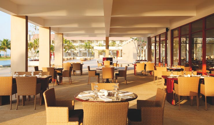 Amaya Beach Resort Sri Lanka restaurant covered dining area tables chairs