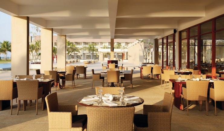 Amaya Beach Resort Sri Lanka restaurant covered dining area tables chairs