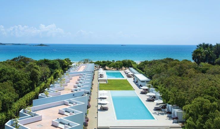 Anilana Nilaveli exterior pools terrace hotel building ocean in background