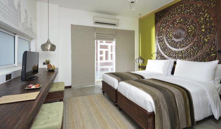 Jetwing Jaffna Sri Lanka deluxe bedroom ornate carved headboard modern décor