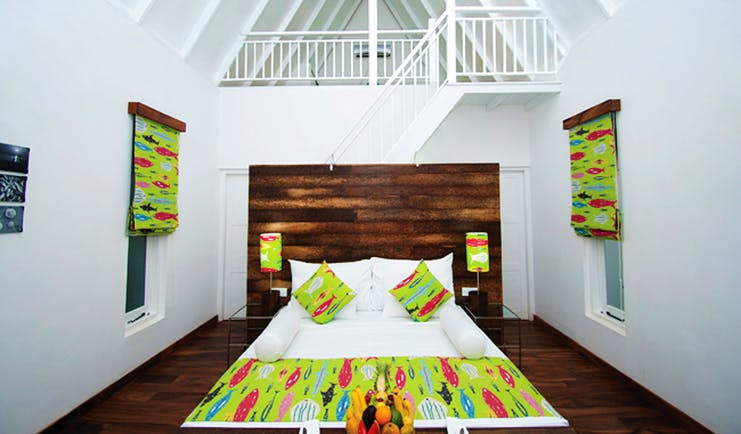 Maalu Maalu Sri Lanka deluxe attic room bed stairs leading to upper level bright modern décor