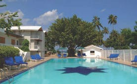 Pigeon Island Resort Sri Lanka pool sun loungers trees