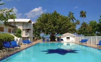 Pigeon Island Resort Sri Lanka pool sun loungers trees