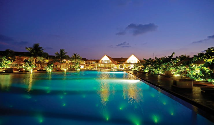 View of the pool and resort lit up at night