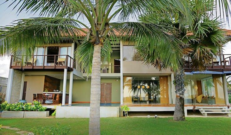Uga Bay Sri Lanka beach villa exterior lawn palm trees private balcony