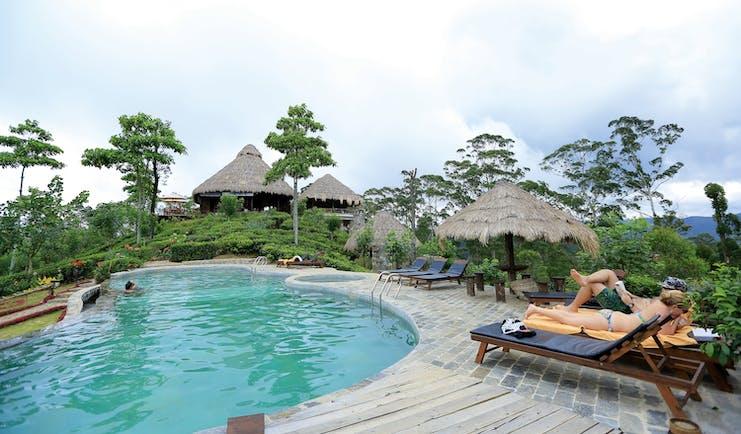 98 Acres Resort Sri Lanka pool sun loungers umbrellas countryside surroundings