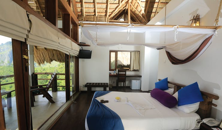 98 Acres Resort Sri Lanka standard room bed canopy modern décor access to private terrace