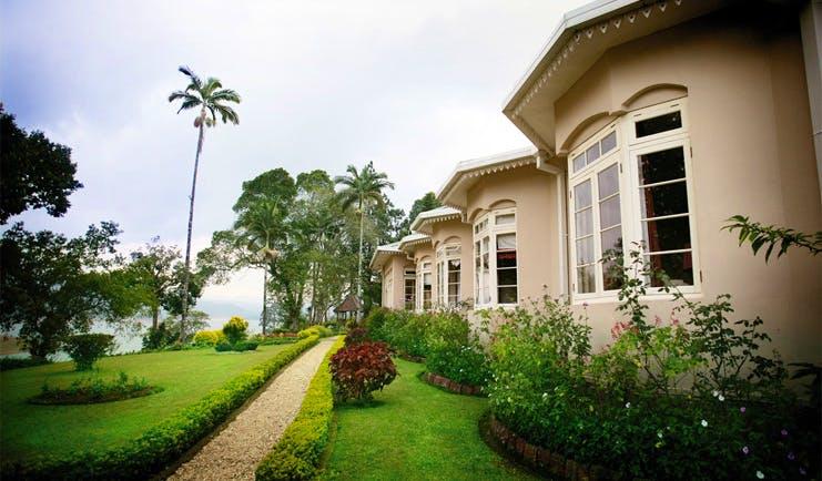 Ceylon Tea Trail Sri Lanka Castlereagh garden path through garden and bungalow front