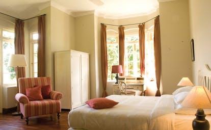 Ceylon Tea Trail Sri Lanka garden suite bedroom bay windows armchair
