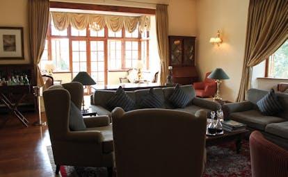 Ceylon Tea Trail Sri Lanka lounge bar bay windows sofa armchairs drinks cabinets