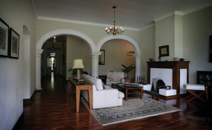 Ceylon Tea Trail Sri Lanka lounge with sofas and fireplace