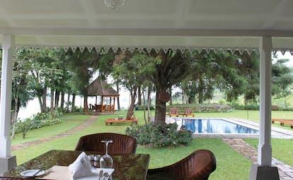 Ceylon Tea Trail Sri Lanka outdoor pool loungers garden and lake view