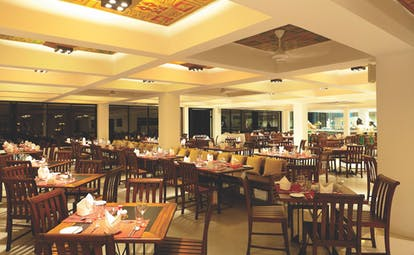 Cinnamon Citadel Sri Lanka restaurant indoor dining area tables chairs bright modern décor
