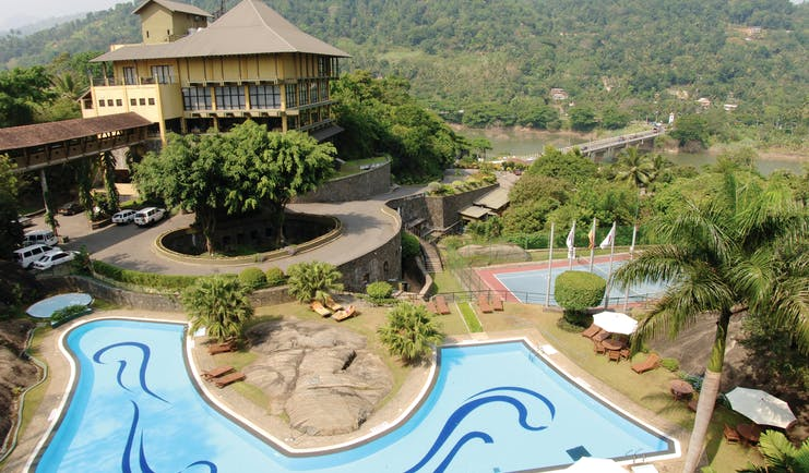 Earl's Regency Sri Lanka exterior hotel building pool tennis courts mountain in background