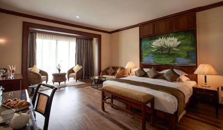 Earl's Regency Sri Lanka luxury room bed seating area large painting modern décor