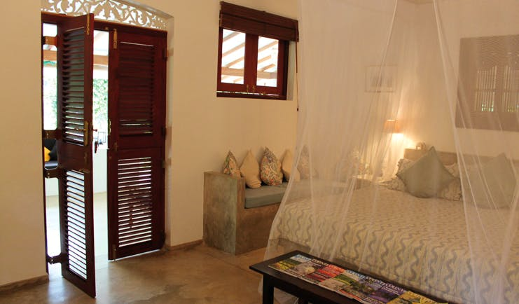 Ellerton Sri Lanka bedroom mosquito drapes sofa balcony access