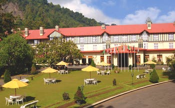 Grand Hotel Nuwara Eliya Sri Lanka exterior hotel building lawns hills in background